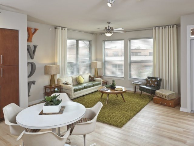 Spacious Living Area with Bright Natural Light & Vinyl Plank Flooring