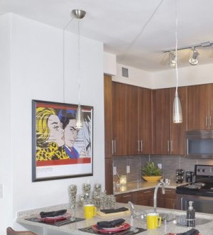Kitchen with breakfast bar at The Can Plant Residences at Pearl, San Antonio, TX,78215