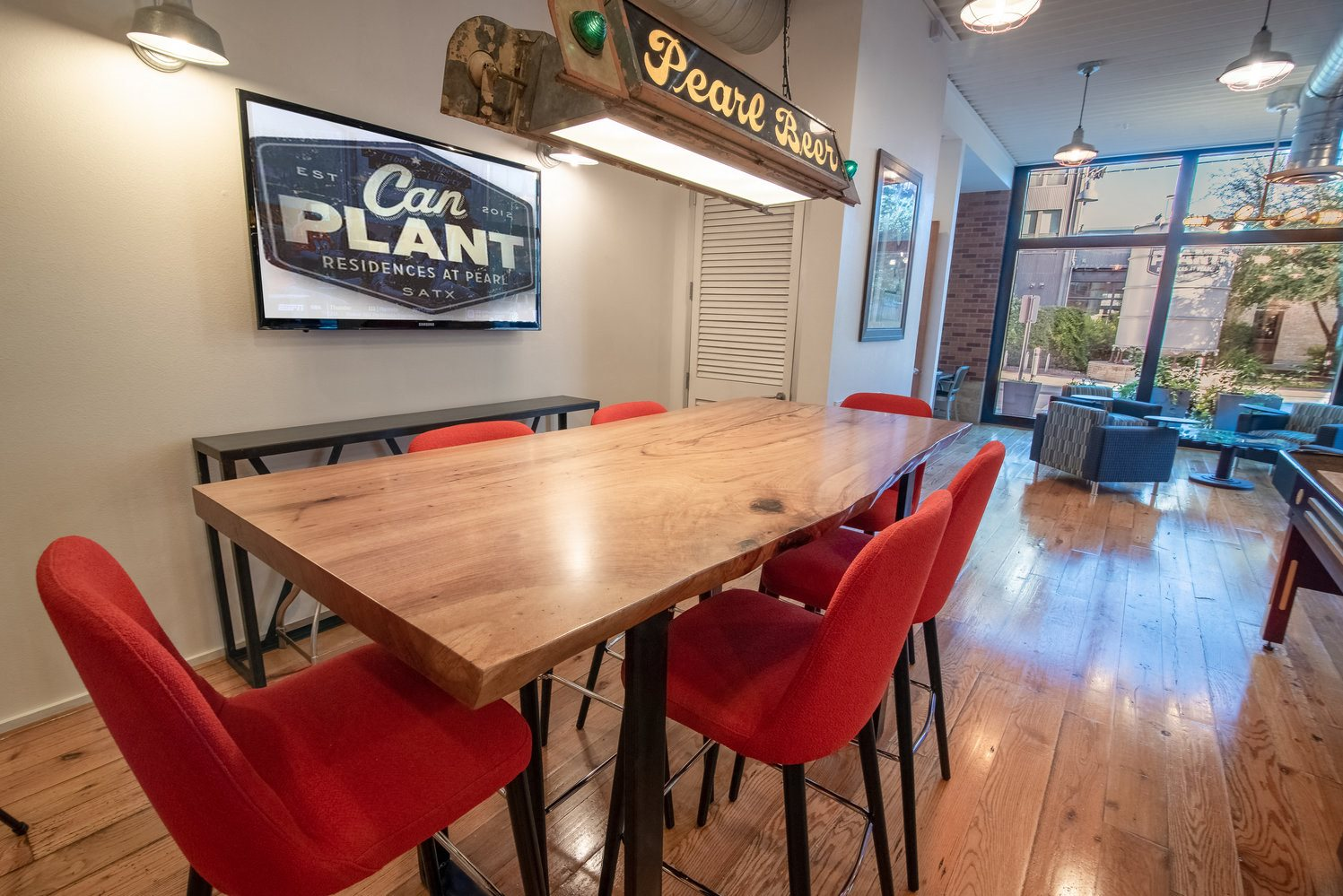 Resident Lounge Conference Table with Vintage Pearl Light Fixture