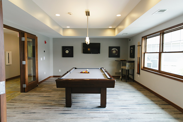 clubhouse with pool table at Valley Creek Apartments, Woodbury, MN 55125