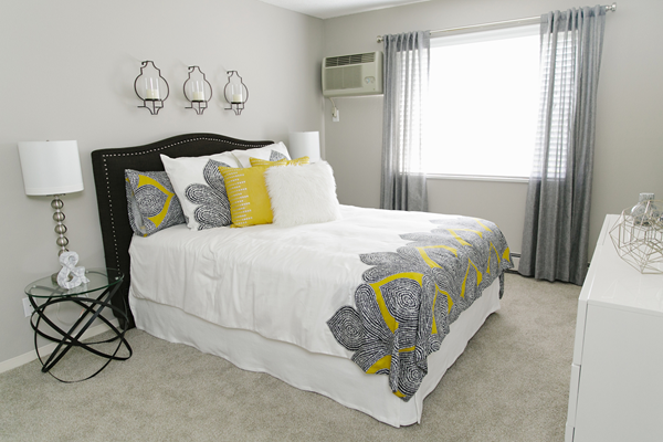 bedroom with large windows at Valley Creek Apartments, Woodbury, MN 55125
