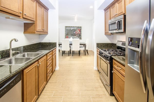 Spacious Kitchen with Pantry Cabinet at Le Blanc Apartment Homes, Canoga Park, CA, 91304