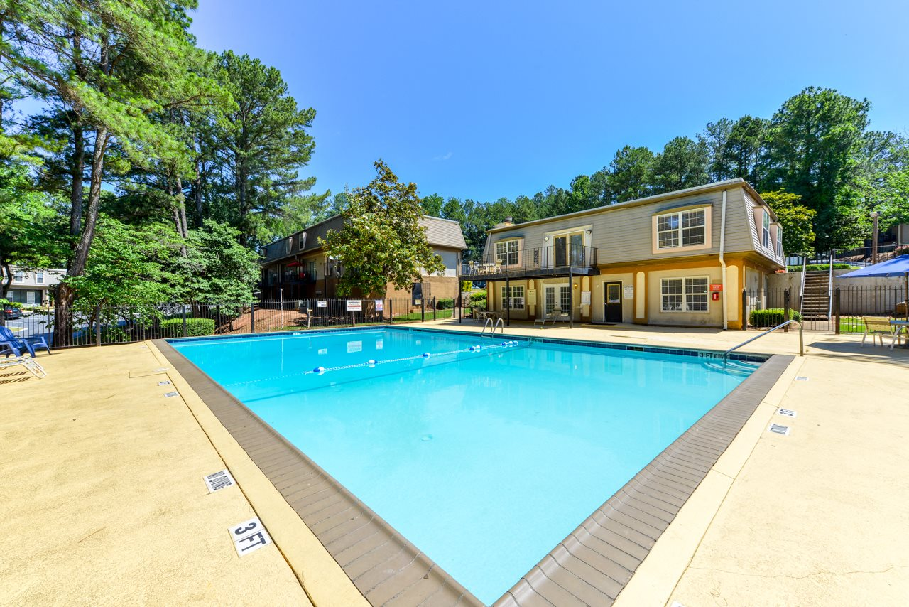 Enjoy long summer days by our sparkling swimming pool | Jonesboro, GA 30236