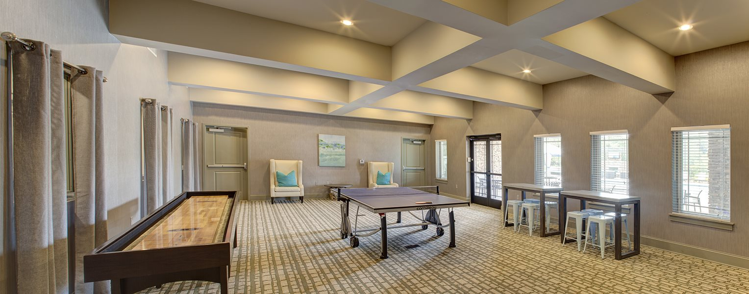 Gaming room at LangTree Lake Norman Apartments