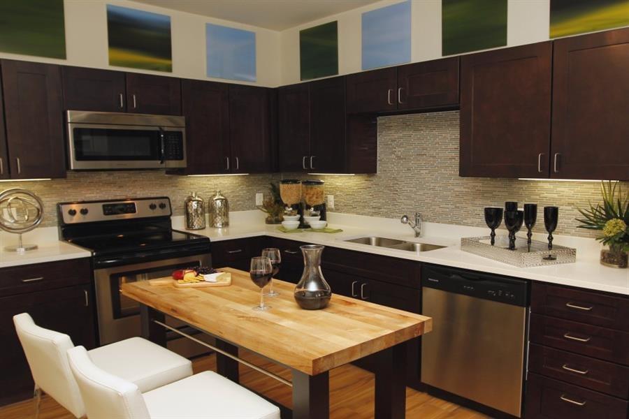 Englewood Apartments Capstone at Vallagio Custom Espresso Cabinetry