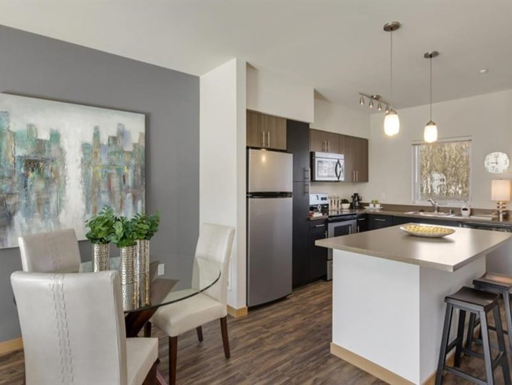 Gourmet Kitchens with Islands, Caesarstone Countertops, and Decorative Backsplash at Trillium Apartments, 4902 148th Street, Edmonds, 98026