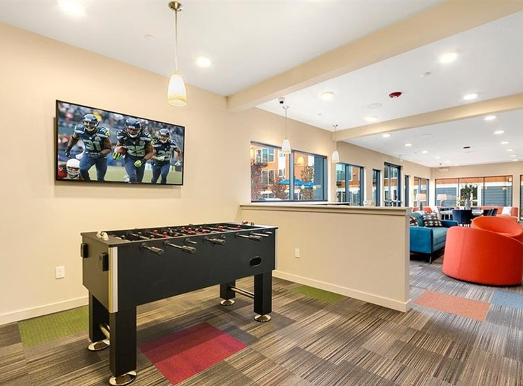 Clubhouse with foosball and TV lounge at Trillium Apartments, 4902 148th Street, Edmonds, WA