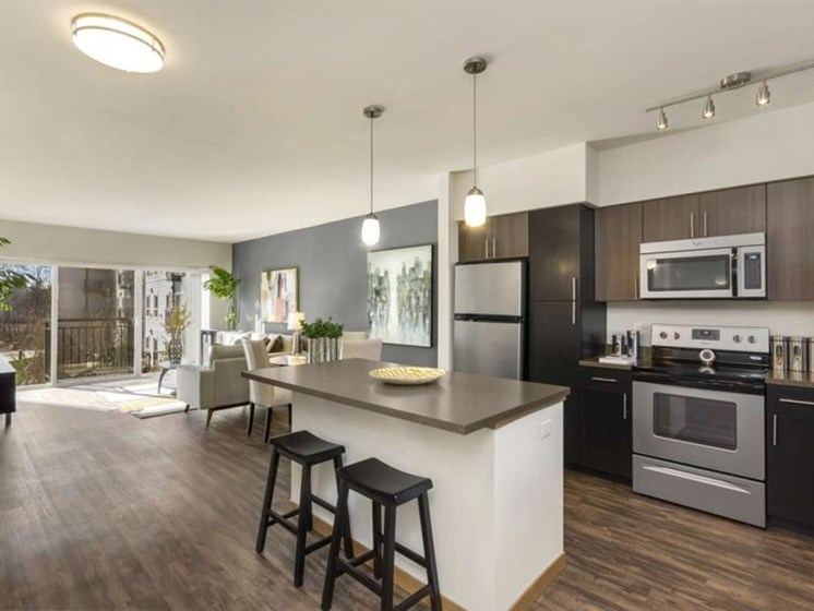 Edmonds WA Apartments - Trillium Apartments Kitchen With Stainless Steel Appliances And Wood Cabinets