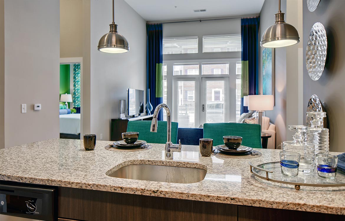 Apartments feature granite countertops in the kitchen and bath.