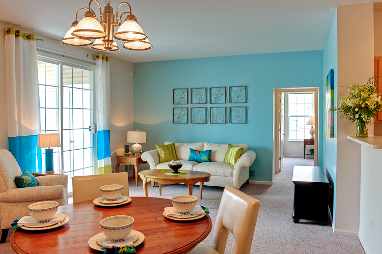 Bright living room at Prairie Point Apartments in Merrillville, IN