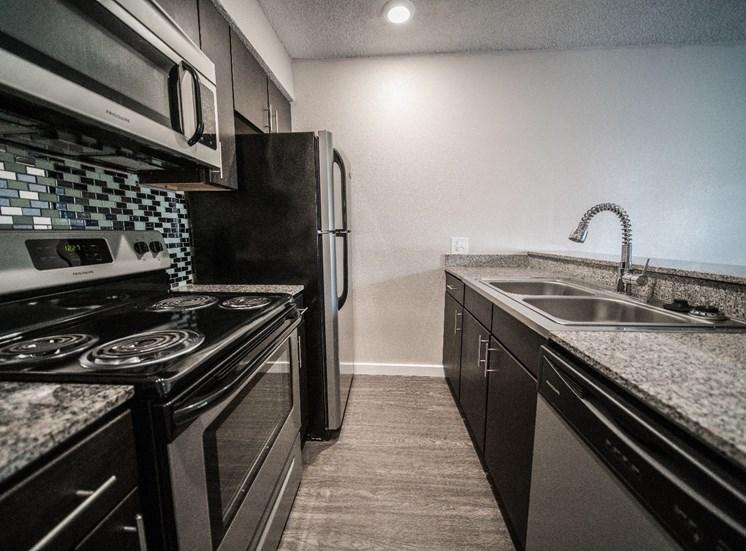 Kitchen with Breakfast Bar at Mesh Properties, Austin, Texas