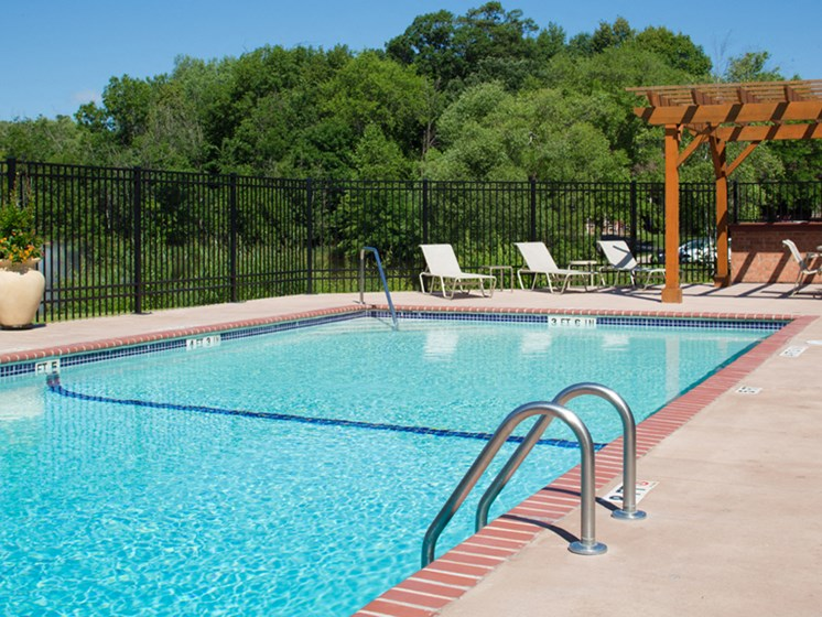 Outdoor pool with sun terrace and lounge seating