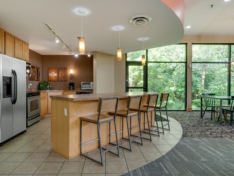 Community room with kitchen and bar seating