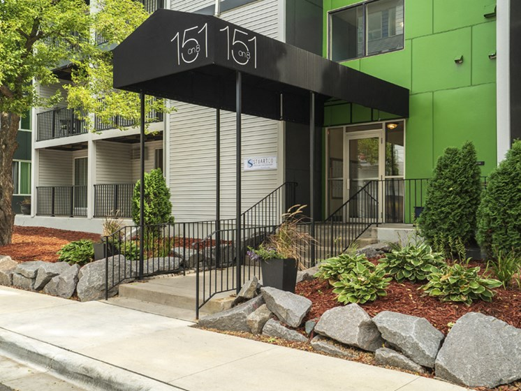 apartment entrance with a black awning that reads