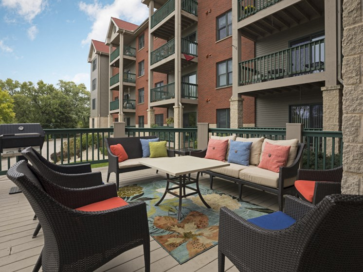 Outdoor deck with patio seating and a grill