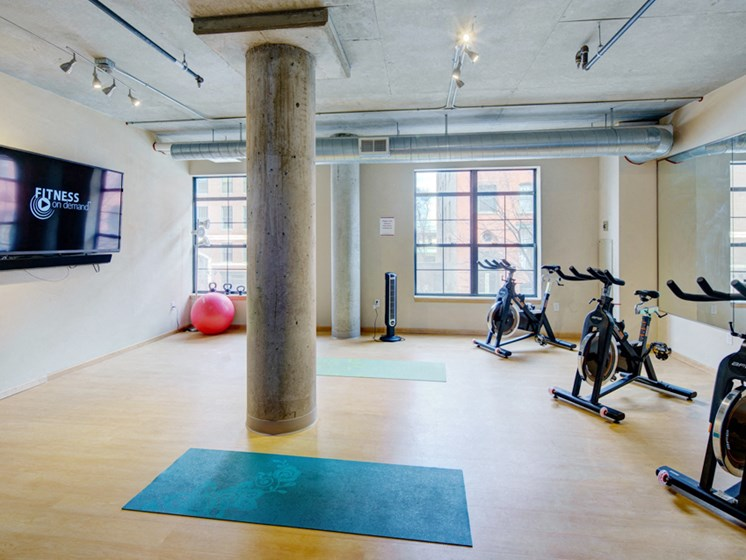 Yoga studio with ellipticals and a TV