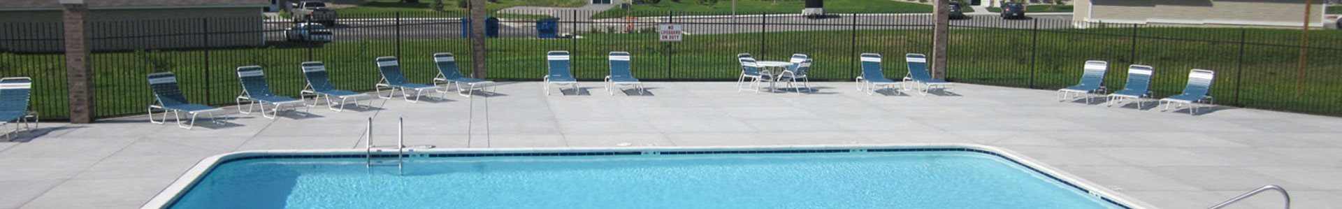 Poolside Sundeck with Chairs and Tables at Colonial Pointe at Fairview Apartments, Nebraska