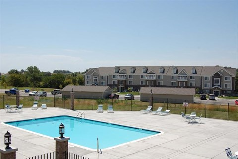 Swimming Pool With Sparkling Water at Colonial Pointe at Fairview Apartments, Bellevue, Nebraska