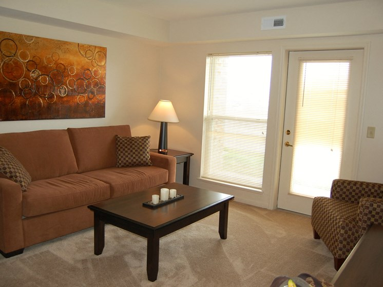 Living Room With Private Balcony at Fieldstream Apartment Homes, Ankeny, IA