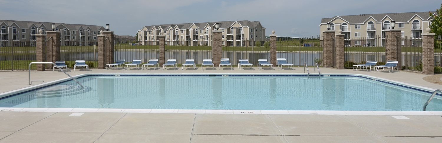 Refreshing Pool With Large Sundeck and Wi-Fi at Hunters Pond Apartment Homes in Champaign, Illinois