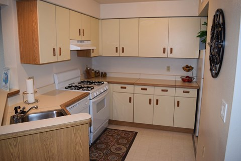 White Appliances In Kitchen at Indian Lakes Apartments, Mishawaka, IN