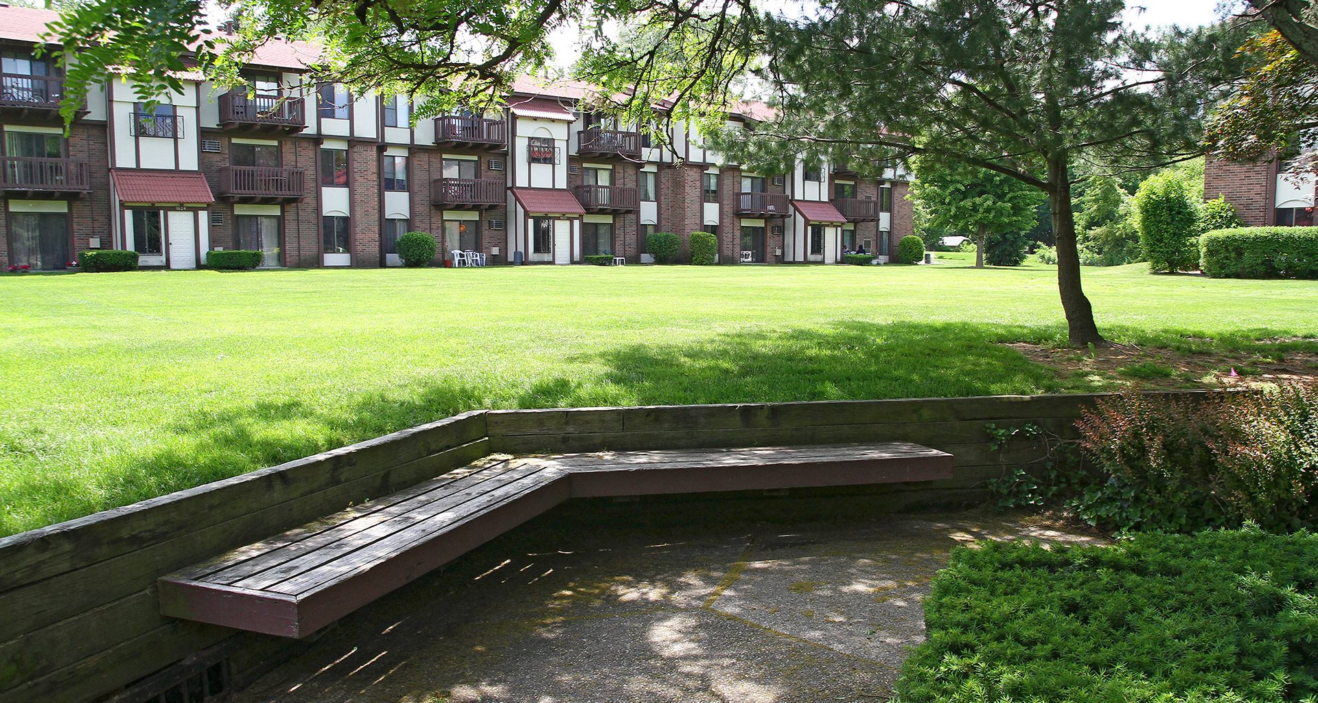 Manicured Lawns with Shade Trees at Madeira Apartments, Kalamazoo, 49001