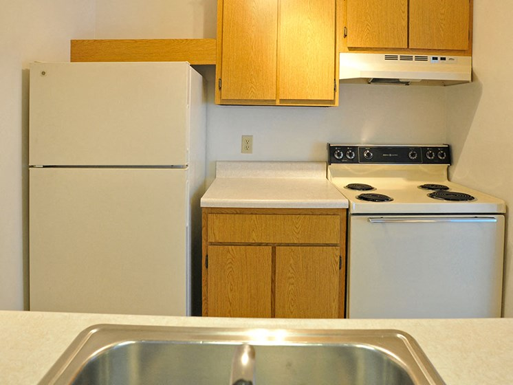 White Appliances in Kitchen at Charter Oaks Apartments, Davison, 48423
