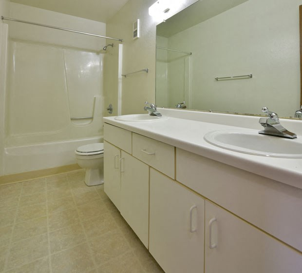 Bathroom with Tile Flooring at Tanglewood Apartments, Oak Creek, WI, 53154
