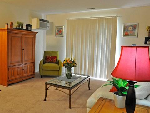 Carpeted Living Room at Rivers Edge Apartments, Michigan