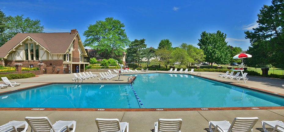 Pool Side Relaxing Area at The Village Apartments, Wixom, MI
