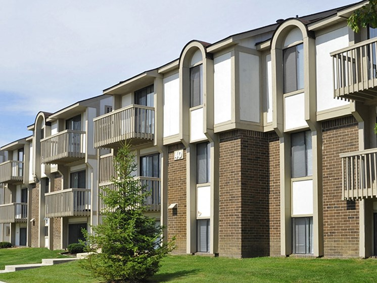 Apartment Building Exterior at The Village Apartments, Michigan, 48393