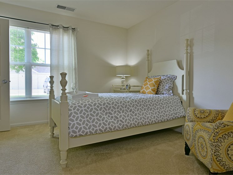 Bedroom with Outdoor Access at Towne Lakes Apartments, 54913