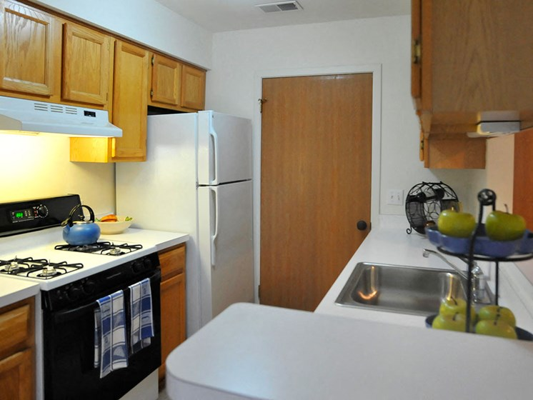 Kitchen with White Appliances at Westlake Apartments, Michigan