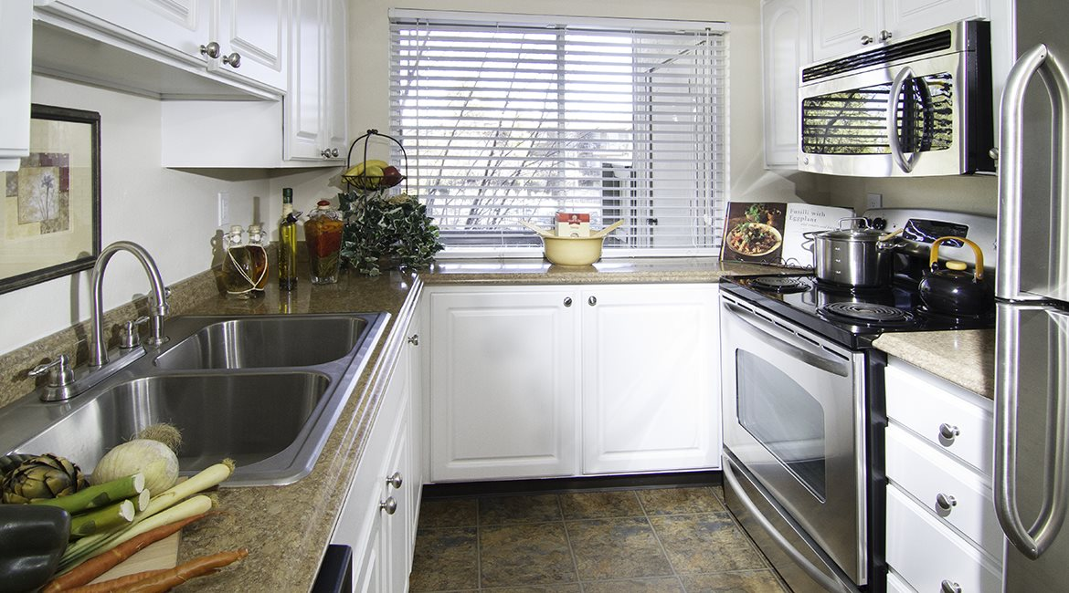 Image of our upgraded kitchen that includes stainless steel appliances and a microwave