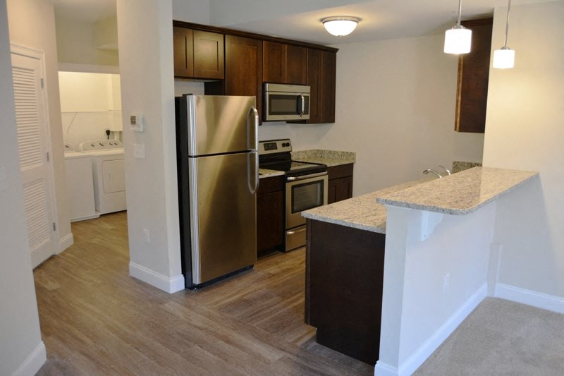 Kitchen and Laundry at Ashland Woods Apartments