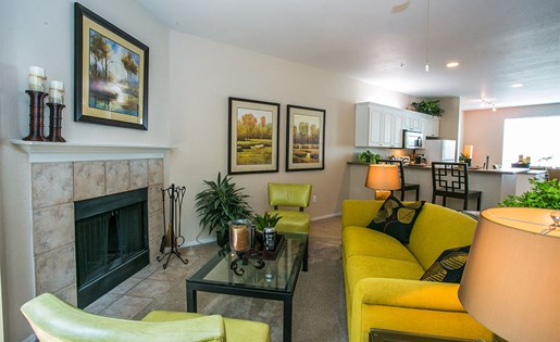 Spacious Living Room with Brick Wood-Burning Fireplace at Apartment Near Tanasbourne Shopping Center