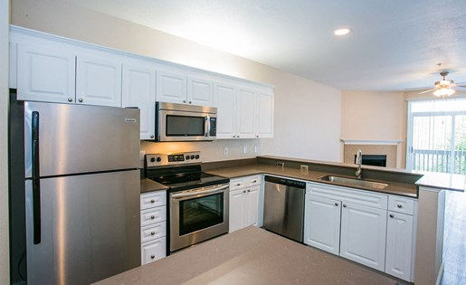Full Gourmet Kitchen with Stainless Steel Microwave & Dishwasher at 97124 Apartment