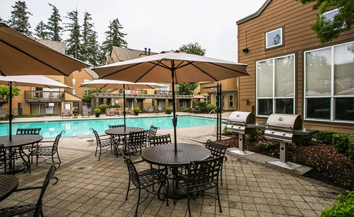 Poolside BBQs and Covered Lounge Seating at Portland Townhomes