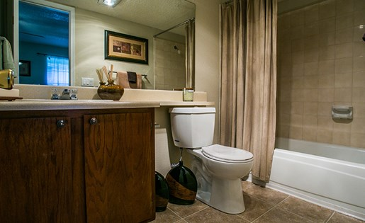 Full Model Bathroom with Shower Tub and Tile Floor at  ABQ Apartments Near I-40