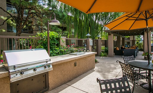 Outside BBQ Grills and Picnic Area with Shaded Seating at ABQ Apartment Near Four Hills Park