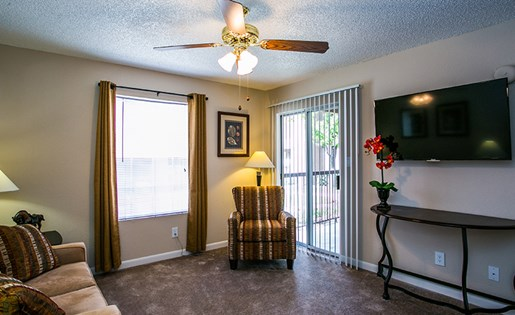 Spacious Model Living Room with Carpeting at Southeast ABQ Apartments