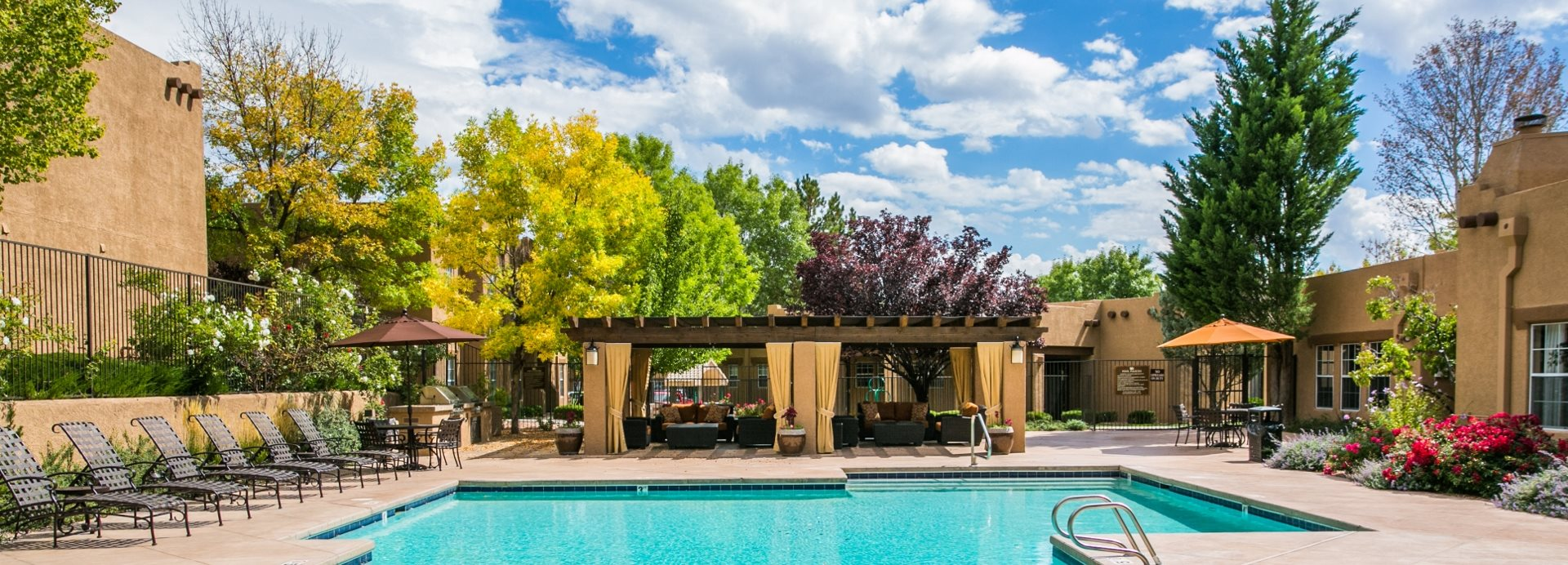 Pool With Sundeck And Lounge Seating In Santa Fe
