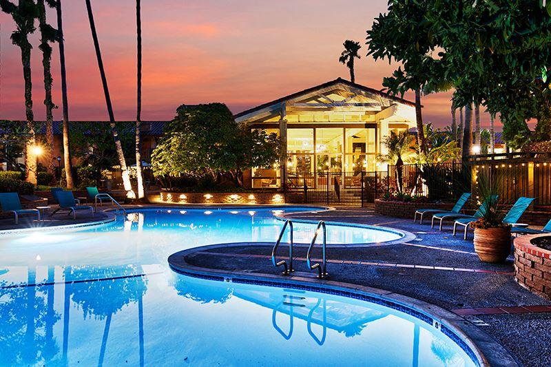 Pool at dusk at Mediterranean Village Apartment Homes