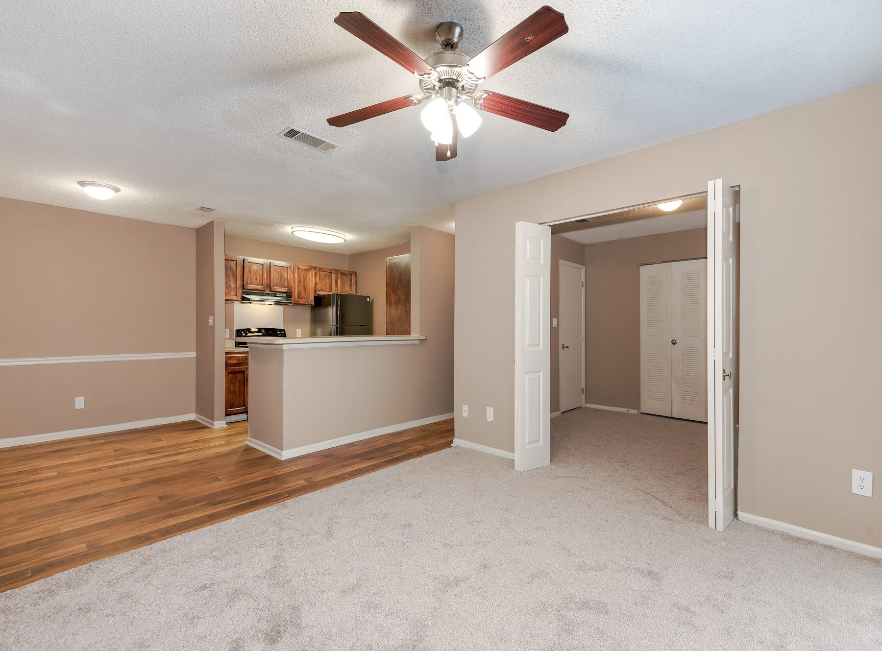 Model Living Area With Carpet And Ceiling Fan