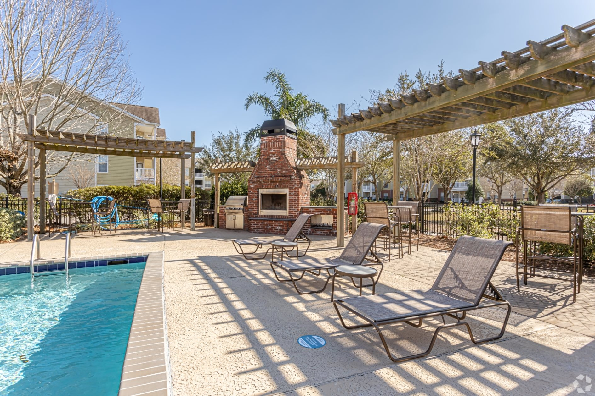 Sparkling Outdoor Pool, Deck and Fireplace