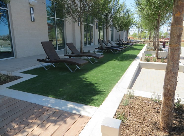 Grassy areas for outdoor relaxing and games  at Discovery at the Realm (Castle Hills), Lewisville, TX,75056