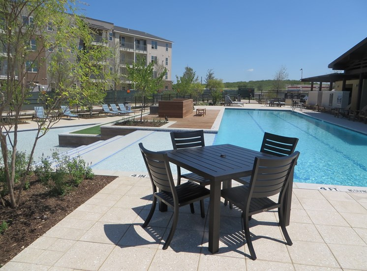 Pool Side Relaxing Area at Discovery at the Realm (Castle Hills), TX