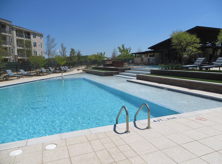 Sparkling Swimming Pool at Discovery at the Realm (Castle Hills), 75056