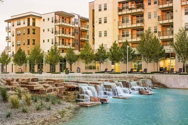 Waterfall in lake at Discovery at The Realm (Castle Hills), Lewisville, TX