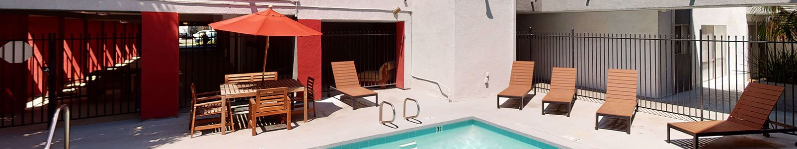 Swimming Pool Area With Shaded Chairs at City Park View, California